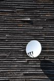 Satellite dish on the wall Stock Image