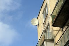 Satellite dish on the wall of the house. Satellite dish on the house wall Stock Photo