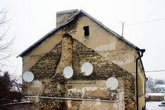 Satellite dish on the wall of a old house Royalty Free Stock Photo