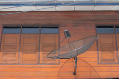 Satellite dish on wall with window Royalty Free Stock Photo