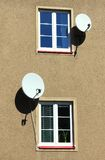 Satellite dish at the window Royalty Free Stock Photos