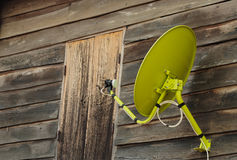 Satellite dish at wooden house Stock Photo