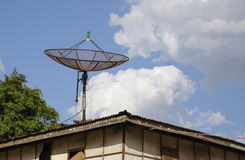 Satellite dish on wooden roof house Stock Photos