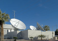 Satellite dishes. At an earth station Stock Photos