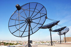Satellite dishes. Group of satellite dishes on the deck Stock Photo