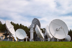 Satellite dishes are aimed at the sky. Base with satellite dishes aimed into space Royalty Free Stock Photos