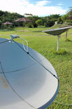 Satellite dishes in the Amazon. In this resort, in the Amazon jungle, TV and communication come through satellite links Royalty Free Stock Photos