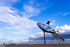 satellite dishes / antenna on the roof of the building with blue Royalty Free Stock Image