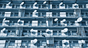 Satellite dishes on balconies Royalty Free Stock Photos