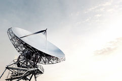 Satellite dishes Connect communications. In the sky and the morning sun Royalty Free Stock Image