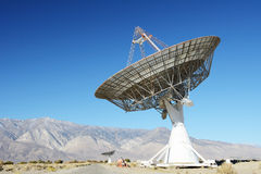 Satellite dishes in desert / clear blue sky Royalty Free Stock Images