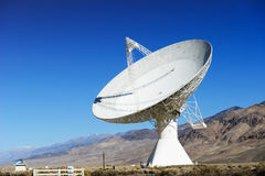 Satellite dishes in desert / clear blue sky Stock Photos