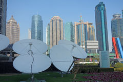 Satellite dishes with modern buildings Royalty Free Stock Images