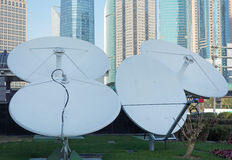 Satellite dishes with modern buildings Royalty Free Stock Photography