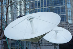 Satellite dishes with modern buildings Stock Image