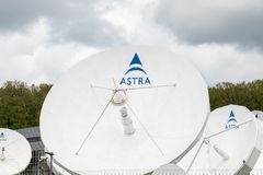 Satellite dishes outside SES in Luxembourg. Betzdorf / Luxembourg - 04 26 2019: Satellite dishes outside the SES headquarters in Luxembourg. SES S.A. is a royalty free stock photography