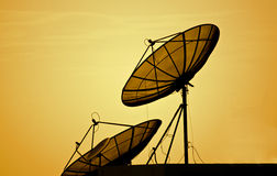 Satellite dishes over sunset Royalty Free Stock Photography