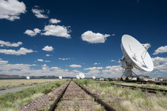Satellite dishes and railroad tracks at the Very Large Array stock photo