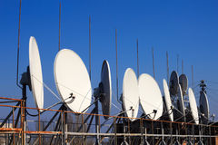 Satellite dishes on the roof Stock Images