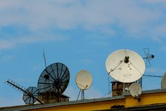 Satellite dishes on the roof of the house royalty free stock photos
