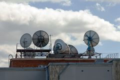 Satellite dishes on the roof. Industrial Satellite dishes, communication signal on the roof of the building. Telecentre Building St. Petersburg royalty free stock photography