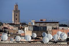 Satellite dishes on roofs Royalty Free Stock Photos