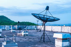 Satellite Dishes on the Rooftop Royalty Free Stock Photos