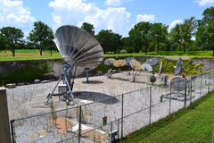 Satellite dishes in secured area Royalty Free Stock Images