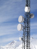 Satellite dishes in snowy mountains at sun day Royalty Free Stock Photography