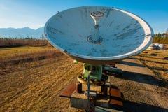 Satellite dishes on summit at sun day Stock Photo