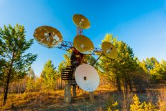 Satellite dishes on summit at sun day Stock Photography