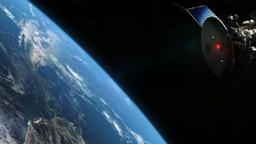 Satellite and earth in orbit Stock Images