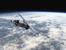 Satellite in earths atmosphere Stock Photos
