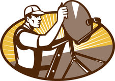 Satellite Installation Technician Worker. Illustration of a tradesman worker installing satellite dish set inside triangle done in retro style Royalty Free Stock Photos