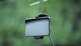 Satellite navigation system on windscreen Royalty Free Stock Images