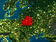 Belarus in red at night. Satellite night view of Belarus highlighted in red on planet Earth. 3D illustration. Elements of this image furnished by NASA Royalty Free Stock Images