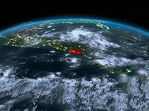 El Salvador from space at night. Satellite night view of El Salvador highlighted in red on planet Earth with clouds. 3D illustration. Elements of this image Stock Photography