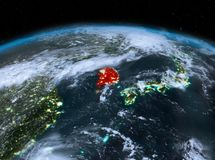 South Korea from space at night. Satellite night view of South Korea highlighted in red on planet Earth with clouds. 3D illustration. Elements of this image Royalty Free Stock Photos