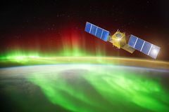 Satellite for observing aurora borealis in Earth orbit, measuring the flow of sun particles, the solar wind. Elements of this stock photography