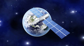 Satellite over the Earth Stock Photo