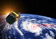 Satellite over a hurricane - Elements of this image furnished by NASA. A satellite flying over a hurricane Stock Images