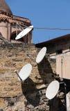 Satellite parabolic antennas. View of some satellite parabolic antennas in the ancient part of the city of palermo, sicily, portrait cut Stock Photo
