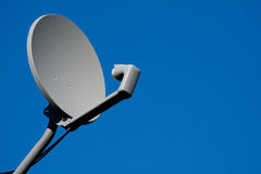 Satellite receiver dish. On a blue sky Stock Photo