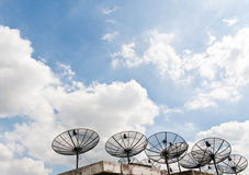 Satellite receiver pointing into blue sky Royalty Free Stock Images