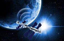 Satellite sending data in space Stock Images