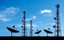 Satellite shadow and phone antenna. Sky background royalty free stock image