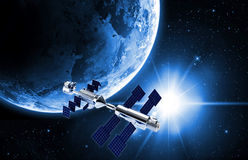 Satellite  in space. Satellite in space with earth and sun light  background Stock Images