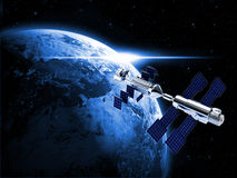 Satellite  in space. Satellite in space with earth and sun light  background Royalty Free Stock Photography