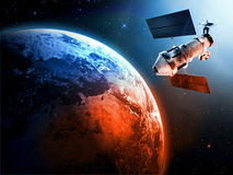 Satellite in space. Sending data to earth Royalty Free Stock Images