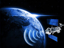 Satellite in space. Sending data to earth Stock Images